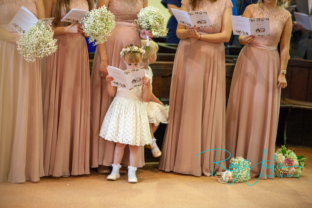 Flower girl singing in church