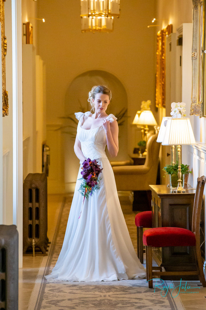 Kelly wearing an Anita Massarella wedding dress. Kendall's jewellery and serendipity flowers at Grantley Hall captured by Ray and Julie