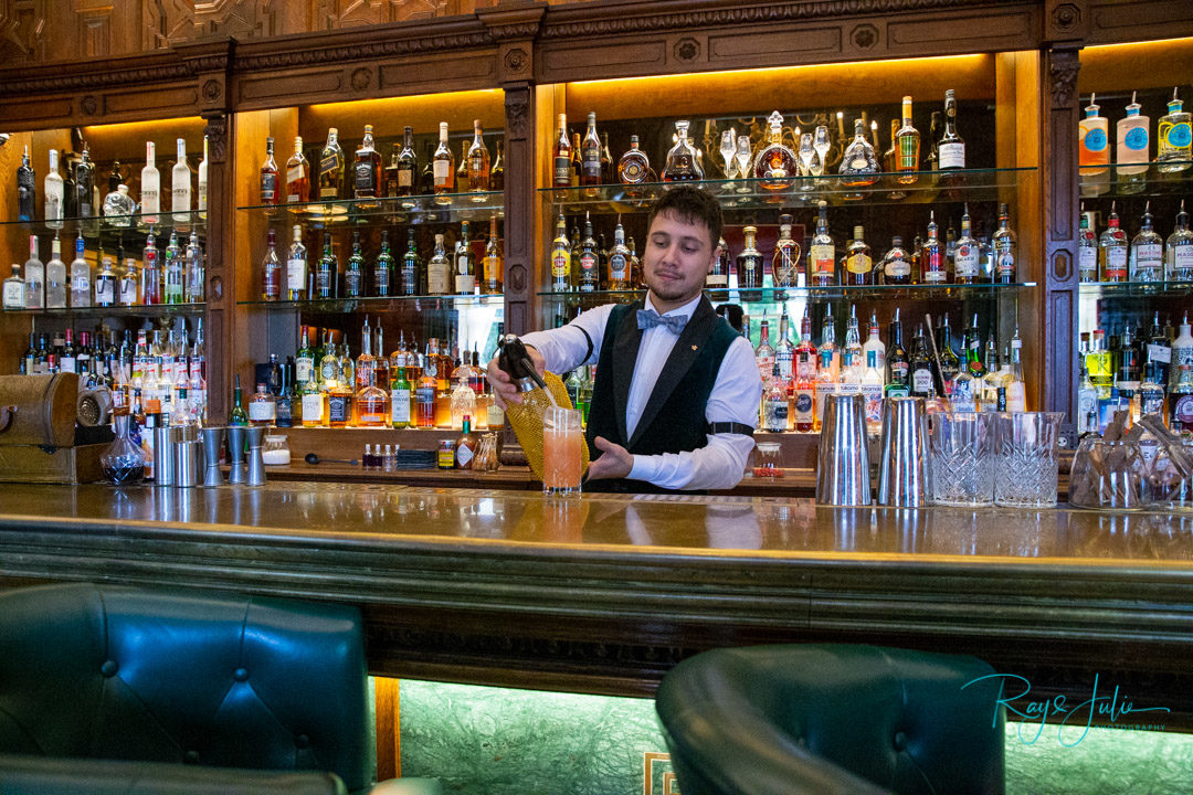 Barman pouring a drink in the Norton Bar at Grantley Hall