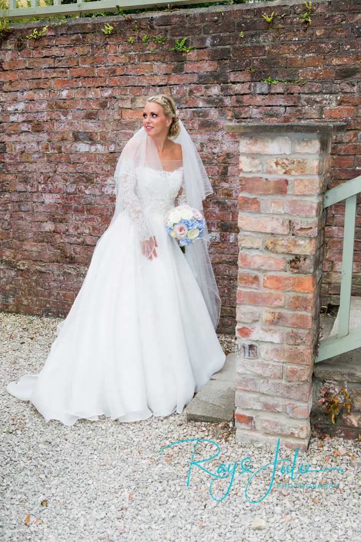 Stunning bride in a Chloe Jane wedding dress in the grounds at Saltmarshe Hall.