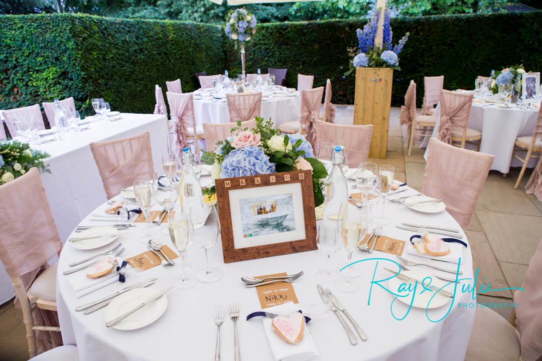 Outdoor wedding breakfast tables set at Saltmarshe Hall, with beautiful flowers from All Occasions of Howden.