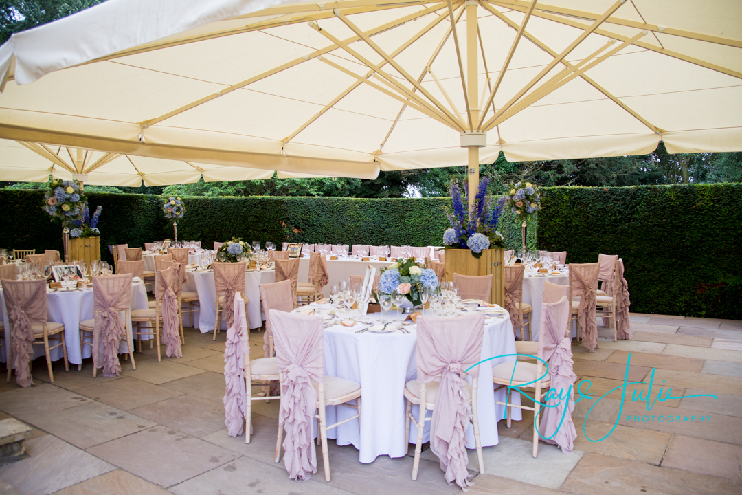 Outdoor wedding breakfast area at Saltmarshe Hall, flowers by All Occasions of Howden.