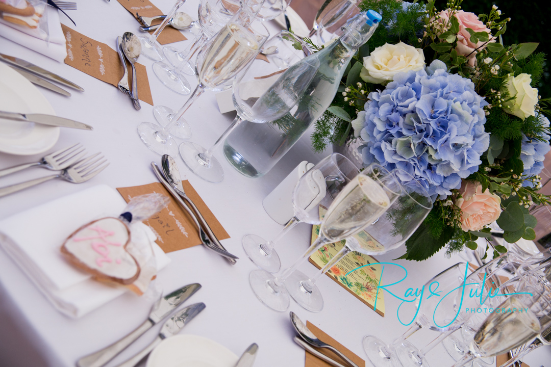 Close up of outdoor wedding breakfast table at Saltmarshe Hall, with flowers from All Occasions in Howden.