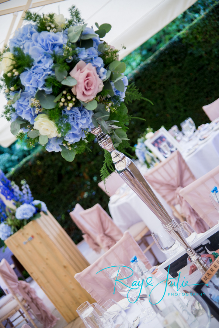 Wedding breakfast table center piece at Saltmarshe Hall. Flowers by All Occasions of Howden.
