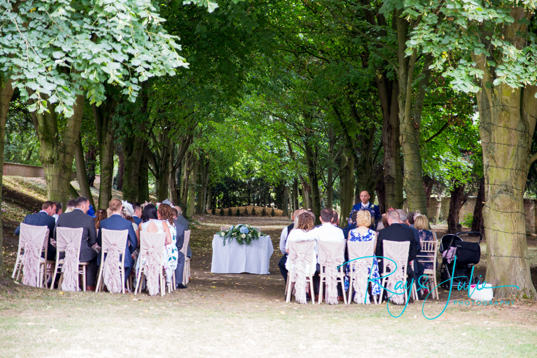 Outdoor wedding ceremony area at Saltmarshe Hall, groom and guests waiting for the bride.