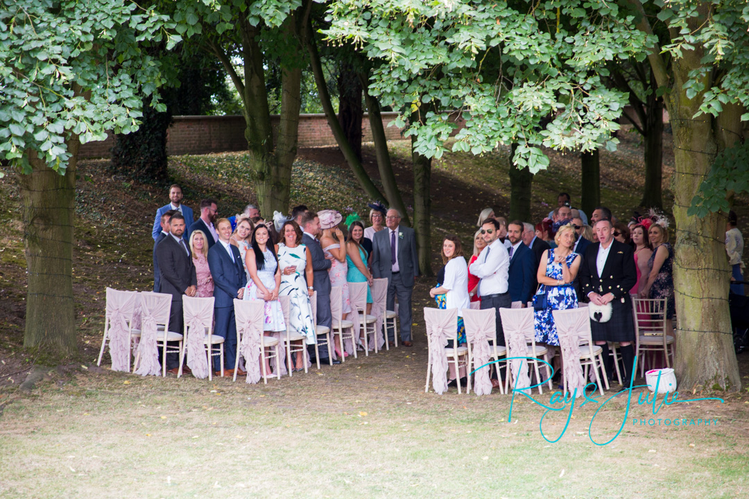 Outdoor ceremony at Saltmarshe Hall with bride about to arrive.