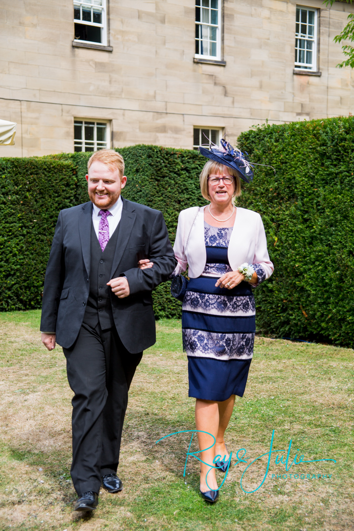 Jake at Saltmarshe Hall escorting the mother of the bride to the outdoor ceremony area.
