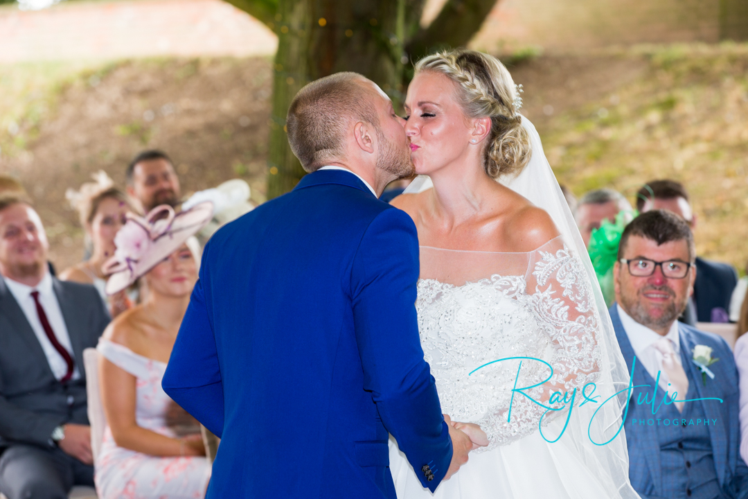 The First Kiss! Captured at Saltmarshe Hall outdoor ceremony.