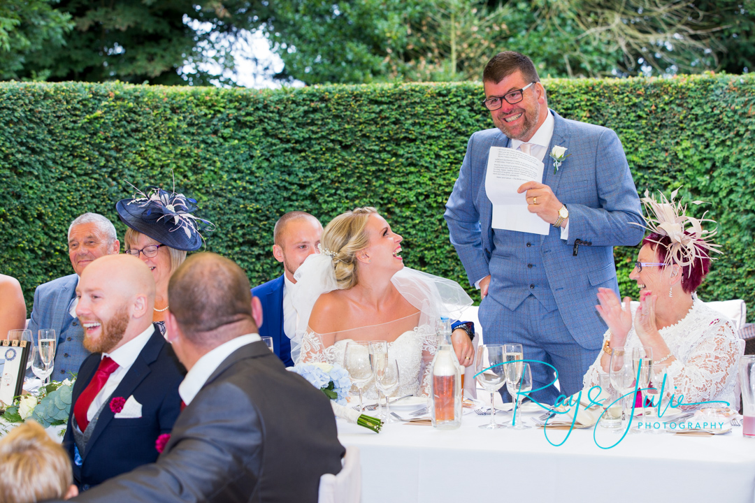 Father of the bride speech at Saltmarshe Hall, everyone laughing.