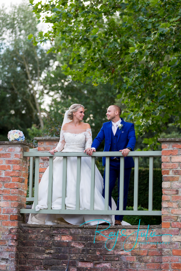 Bride and Groom having an intimate glance at each other, captured at Saltmarshe Hall after their outdoor wedding ceremony.