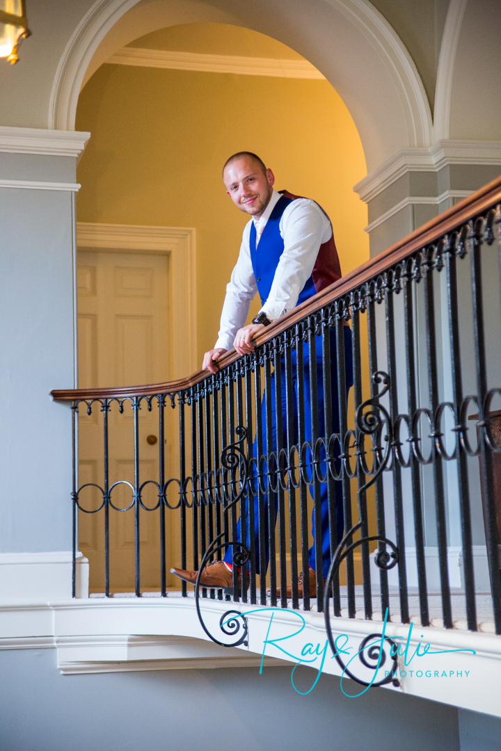 A very happy relaxed groom after the ceremony stood on the balcony in Saltmarshe Hall.
