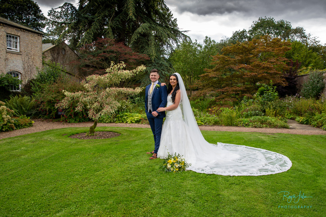 Bride and Groom outdoor autumn wedding photograph captured in the grounds at Saltmarshe Hall East Riding of Yorkshire.