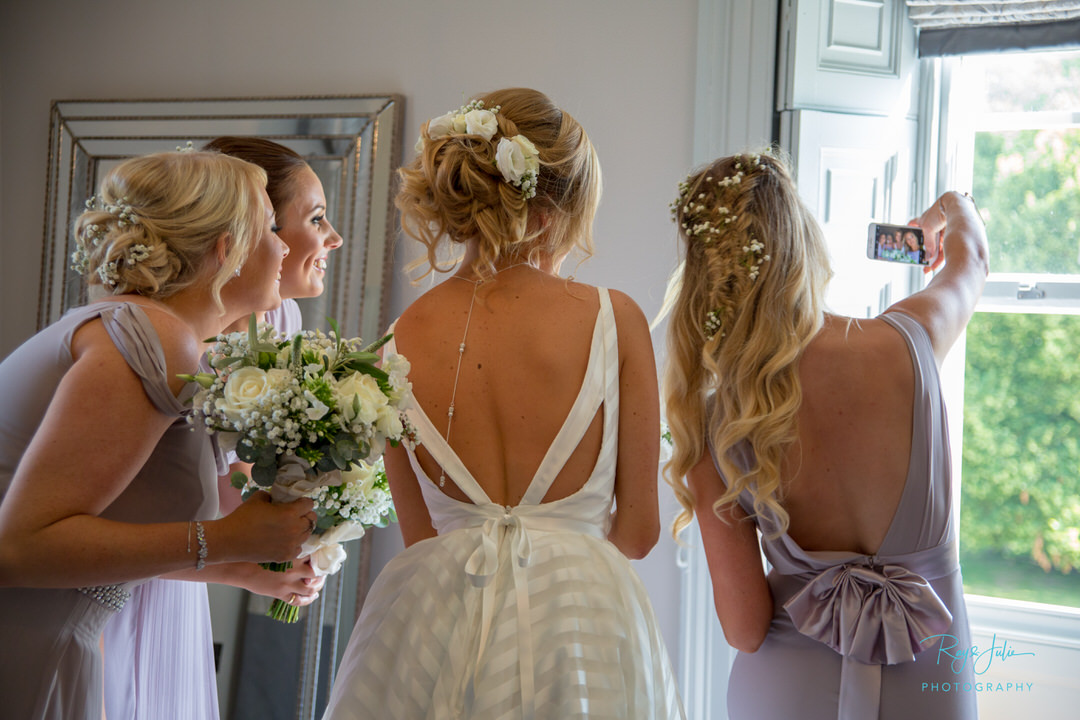 Bridal party selfie time prior to getting married at Saltmarshe Hall. Photograph by Ray and Julie Photography