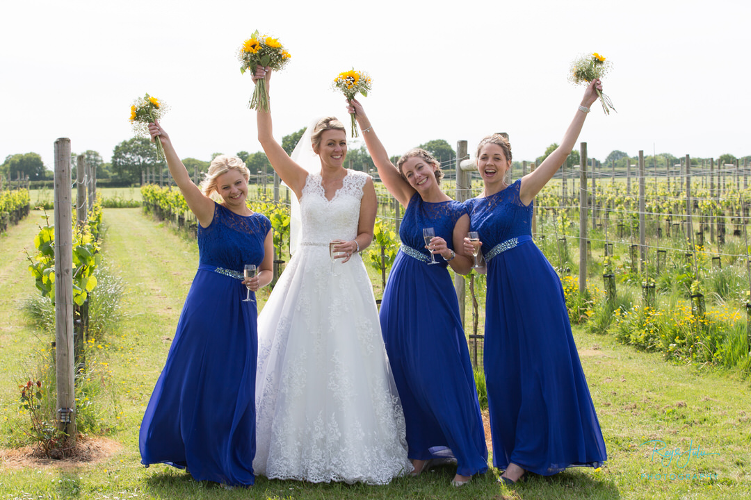 Bride and bridesmaids celebrating with a glass of champagne. Wedding venue Yorkshire Heart Vineyard.
