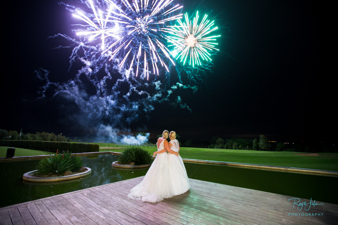 Bride and bride watching fireworks at the end of their wedding night. Photograph taken at The KP Club East Yorkshire