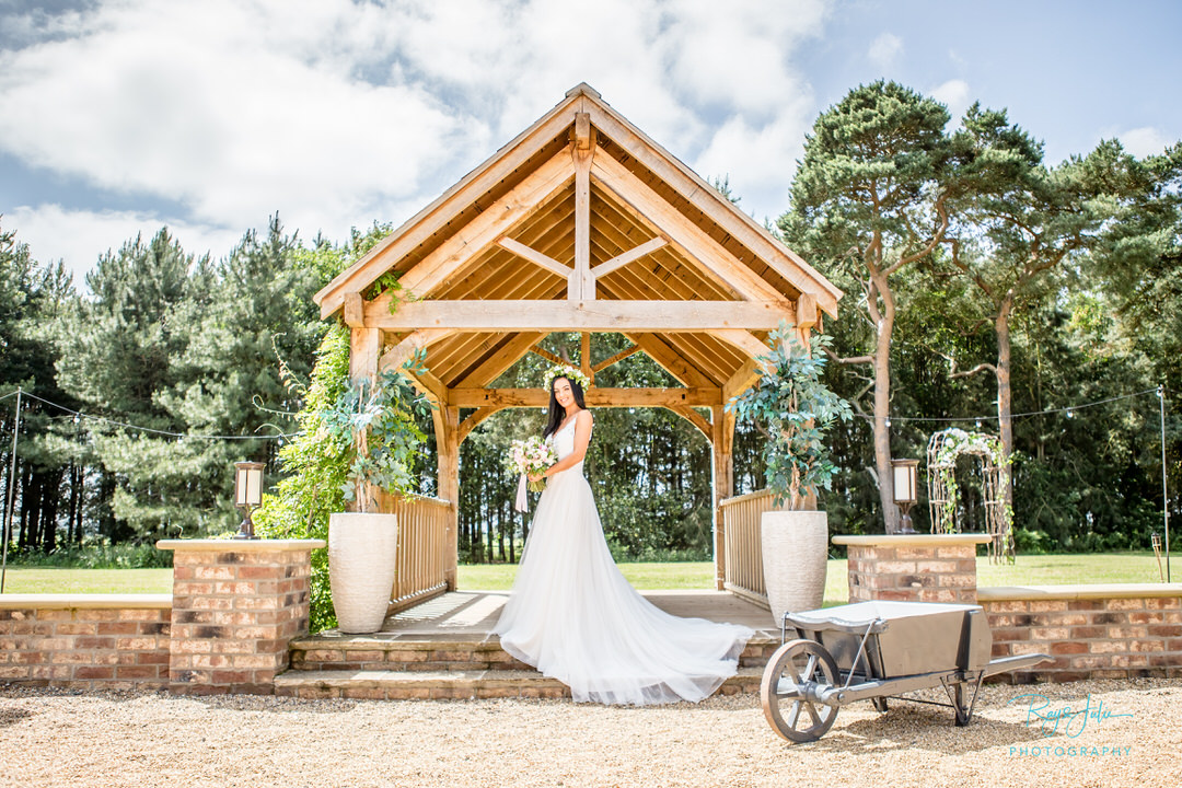 Bride outside at Bunny Hill Weddings. Photograph by recommended supplier Ray and Julie Photography
