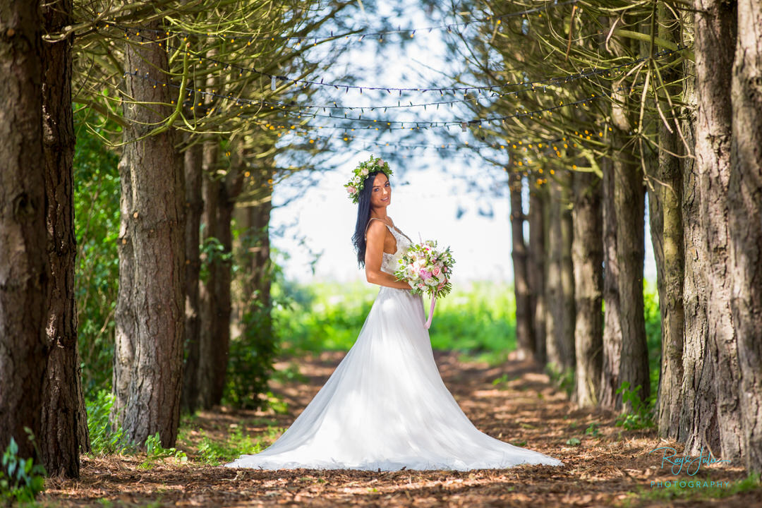 Bride outside in the woods at Bunny Hill Weddings. Photograph by recommended supplier Ray and Julie Photography