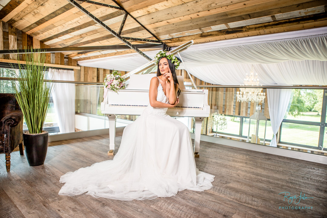 Bride sat by the piano at Bunny Hill Weddings, photograph by recommended supplier Ray and Julie Photography