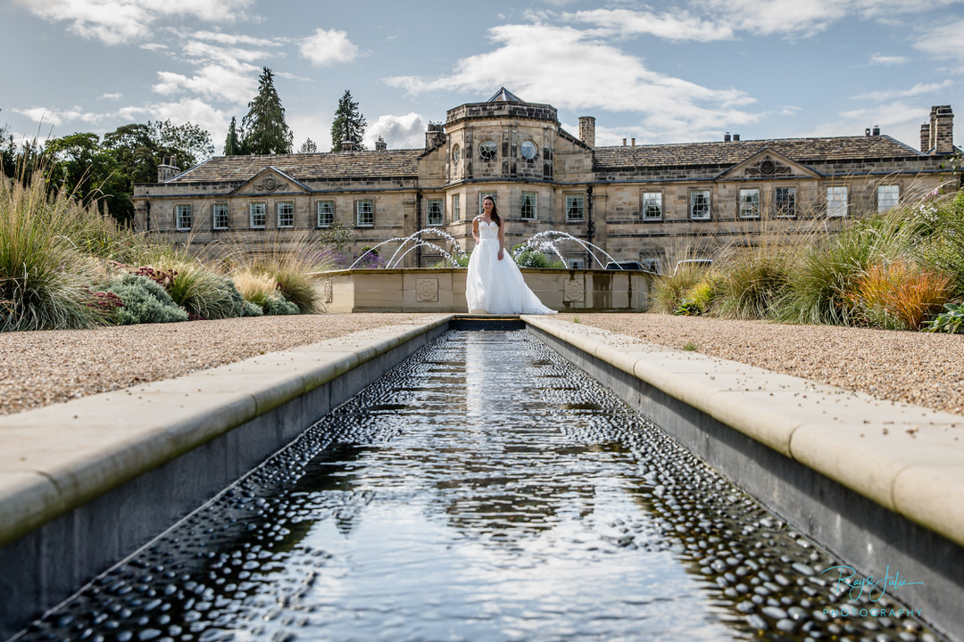 Bride in wedding dress outside Grantley Hall, photography by recommended supplier Ray and Julie Photography