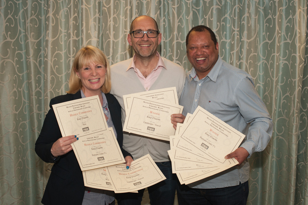 Receiving Photography Awards - Ray and Julie Photography