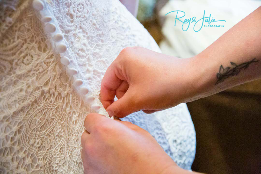 Wedding Dress - Photograph- detail photo fastening the dress