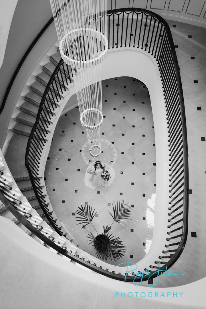 Beautiful bride inside Grantley Hall with spiral staircase