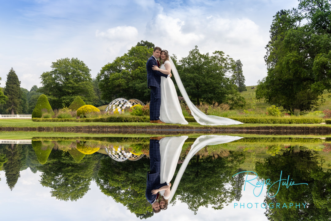 Beautiful reflection of wedding couple taken in the grounds at Grantley Hall
