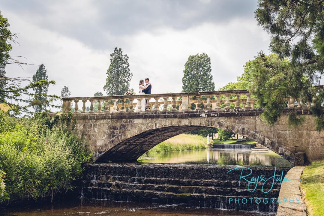 Wedding couple on a bridge at Grantley Hall