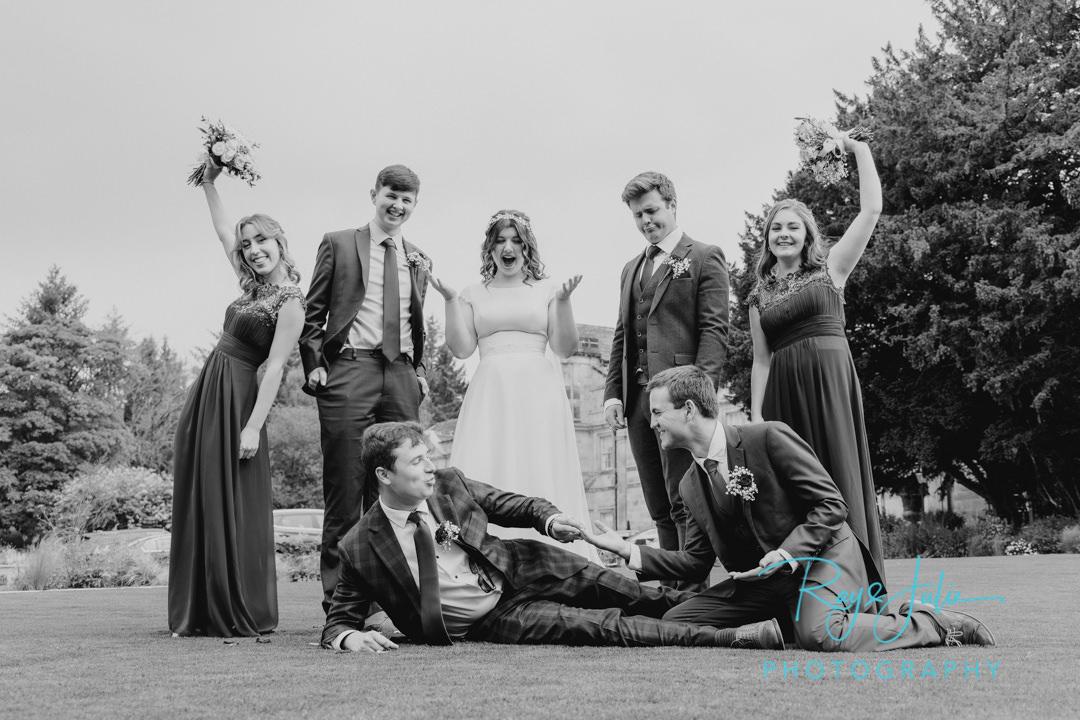 Bridal party having fun outside Grantley Hall