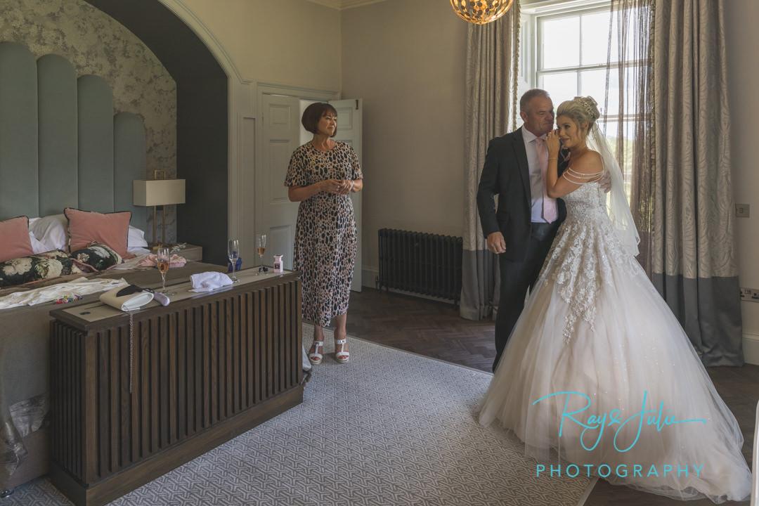 Bride reveal to dad, mum looking on. Very emotional at Saltmarshe Hall