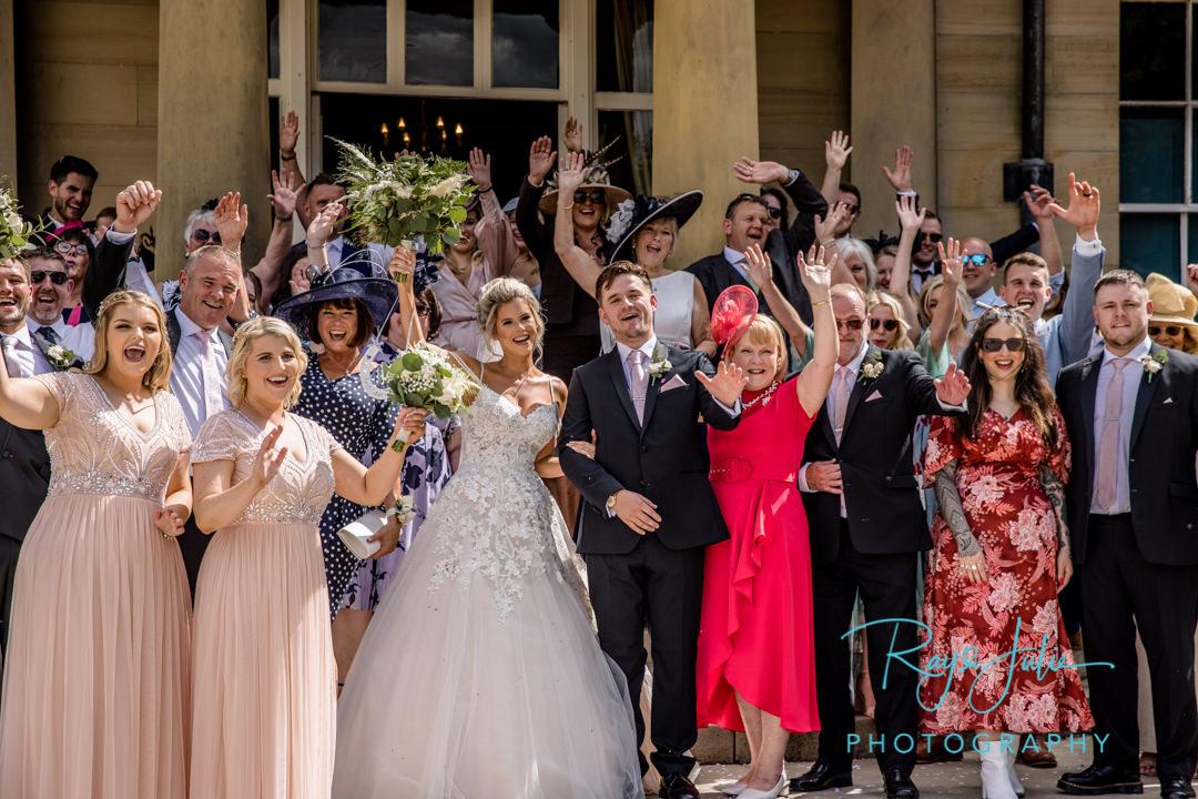 Wedding group photo on the steps at Saltmarshe Hall