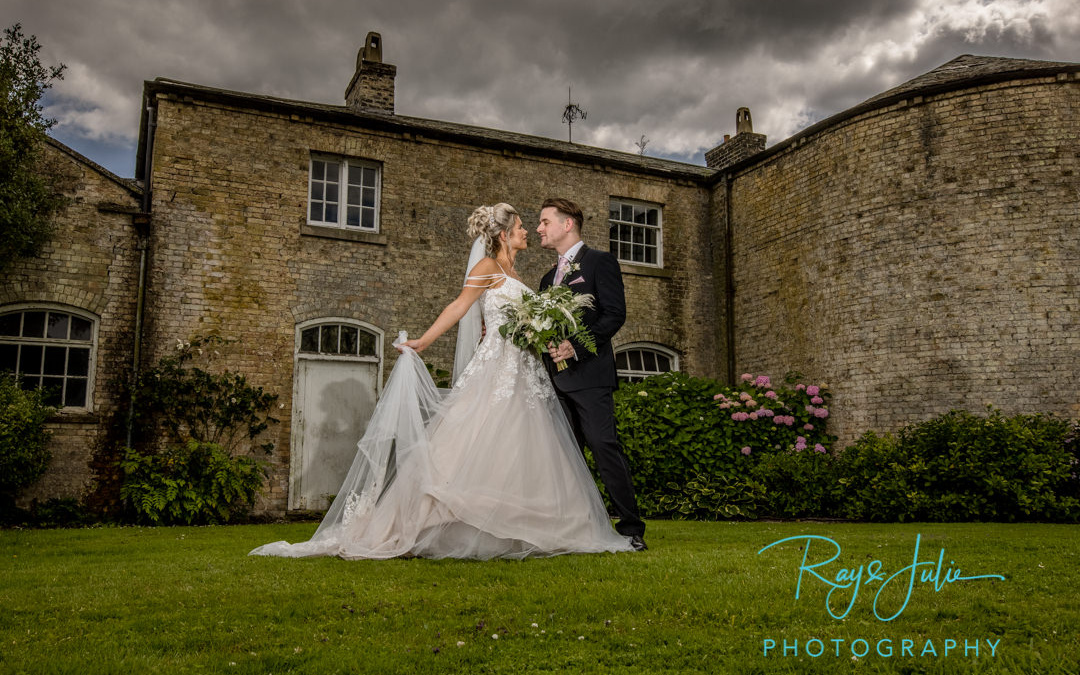 Dramatic wedding portrait captured in the grounds at Saltmarshe Hall