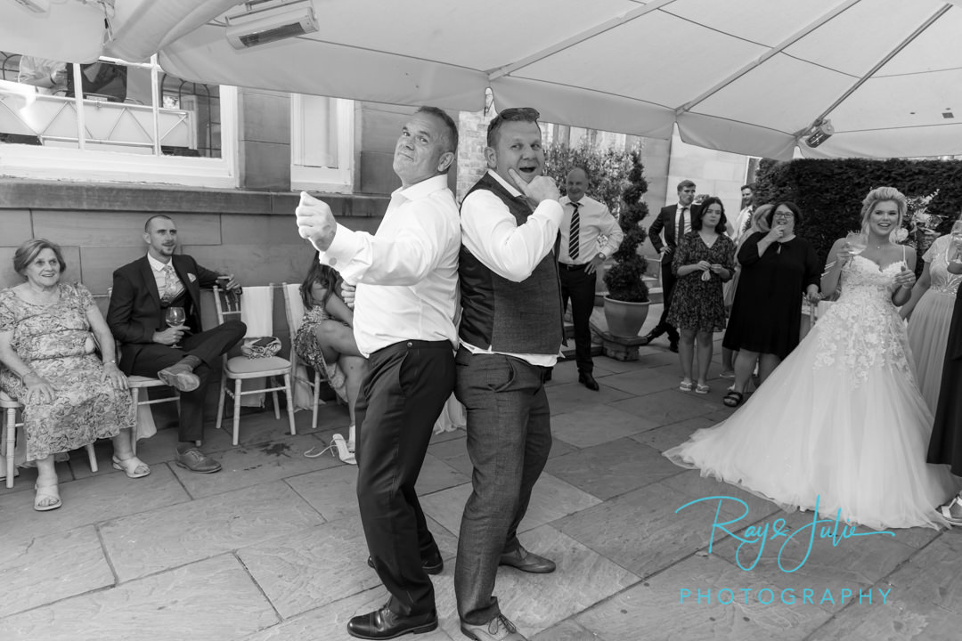 Father of the bride busting some moves with his daughter watching on at Saltmarshe Hall