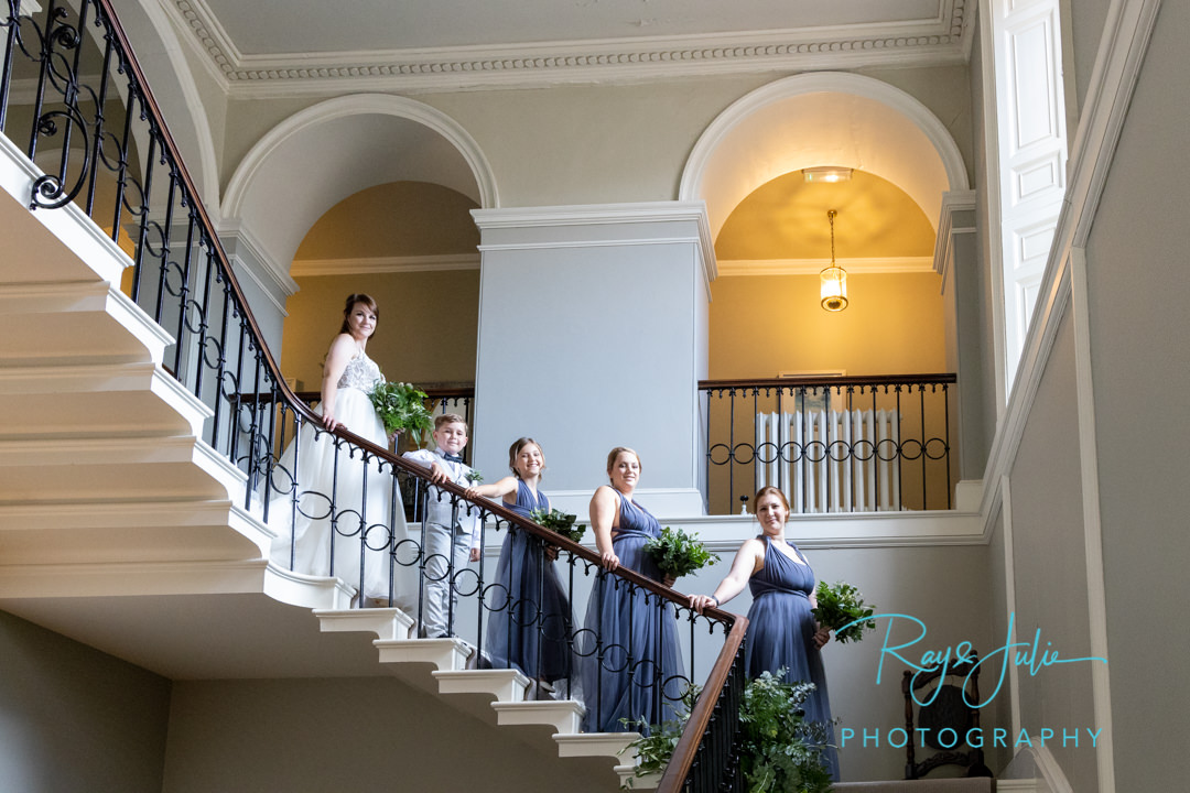 Bride with bridal party coming down the stairs at Saltmarshe Hall