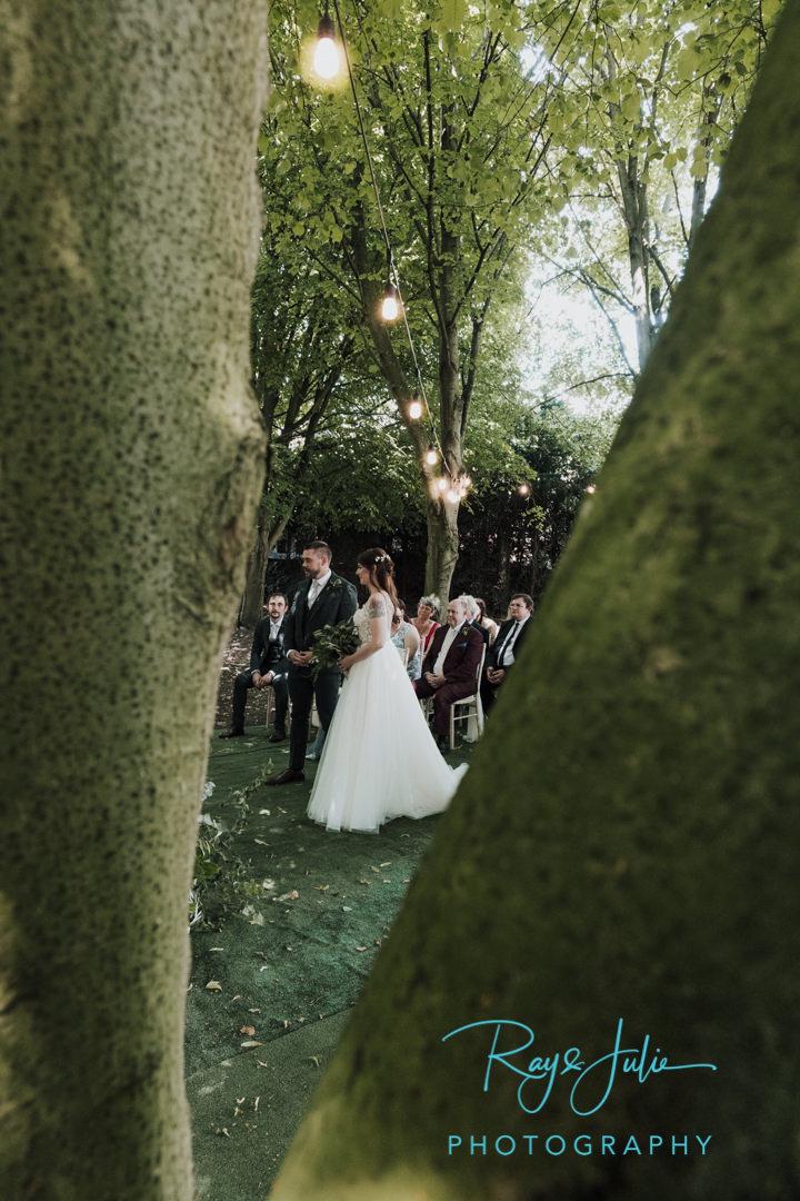 Serene outdoor woodland wedding setting under the trees at Saltmarshe Hall