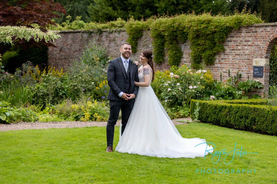 Bride and Groom outdoor summer wedding photograph captured at Saltmarshe Hall East Riding of Yorkshire.
