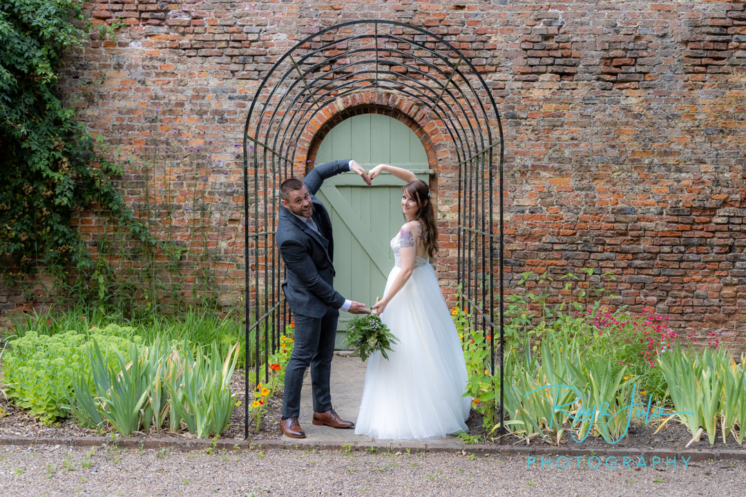 Bride and Groom make love heart shape