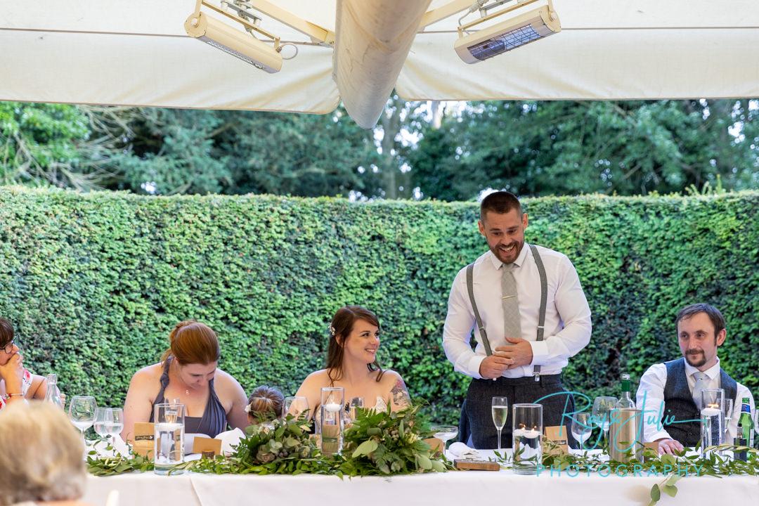 Groom doing his speech during wedding reception
