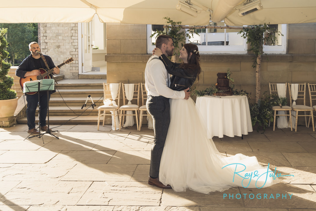 First dance outdoor with singer in the background
