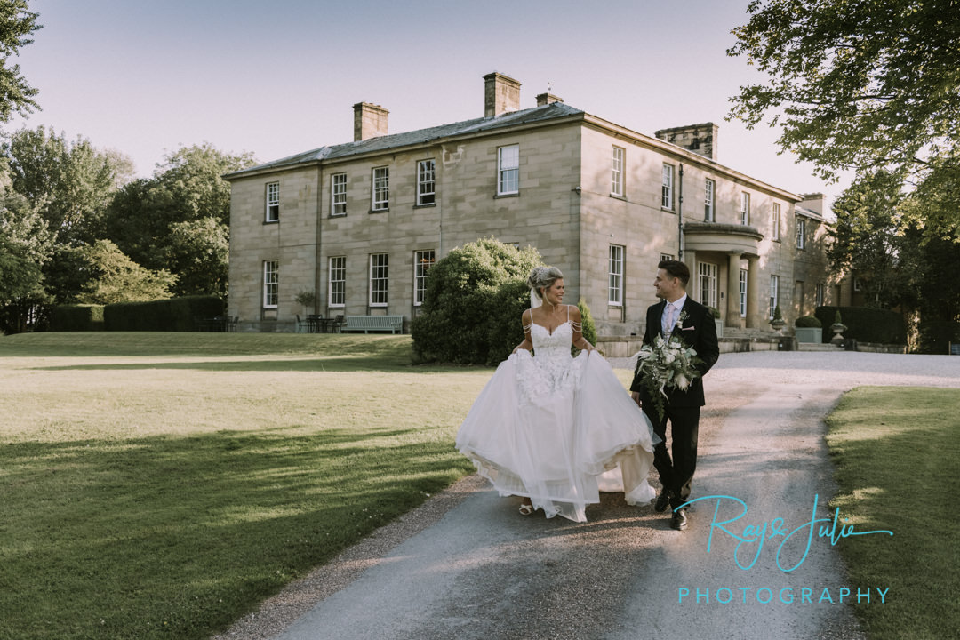Bride and Groom wedding photograph walking down the drive at Saltmarshe Hall East Riding of Yorkshire.