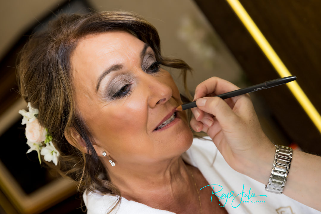 beautiful bride having bridal prep in the Presidential Suit at Grantley Hall. Make-up by Naomi Stone MUA