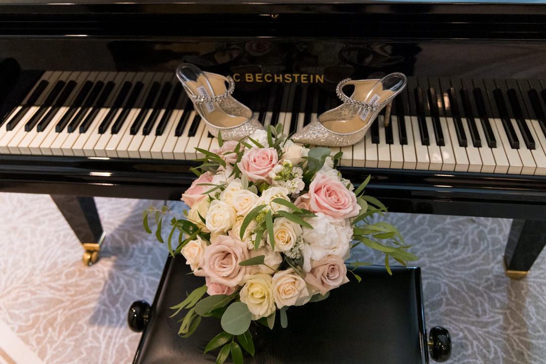 Jimmy Choo wedding shoes on a Bechstein piano at Grantley Hall in the Presidential Suit
