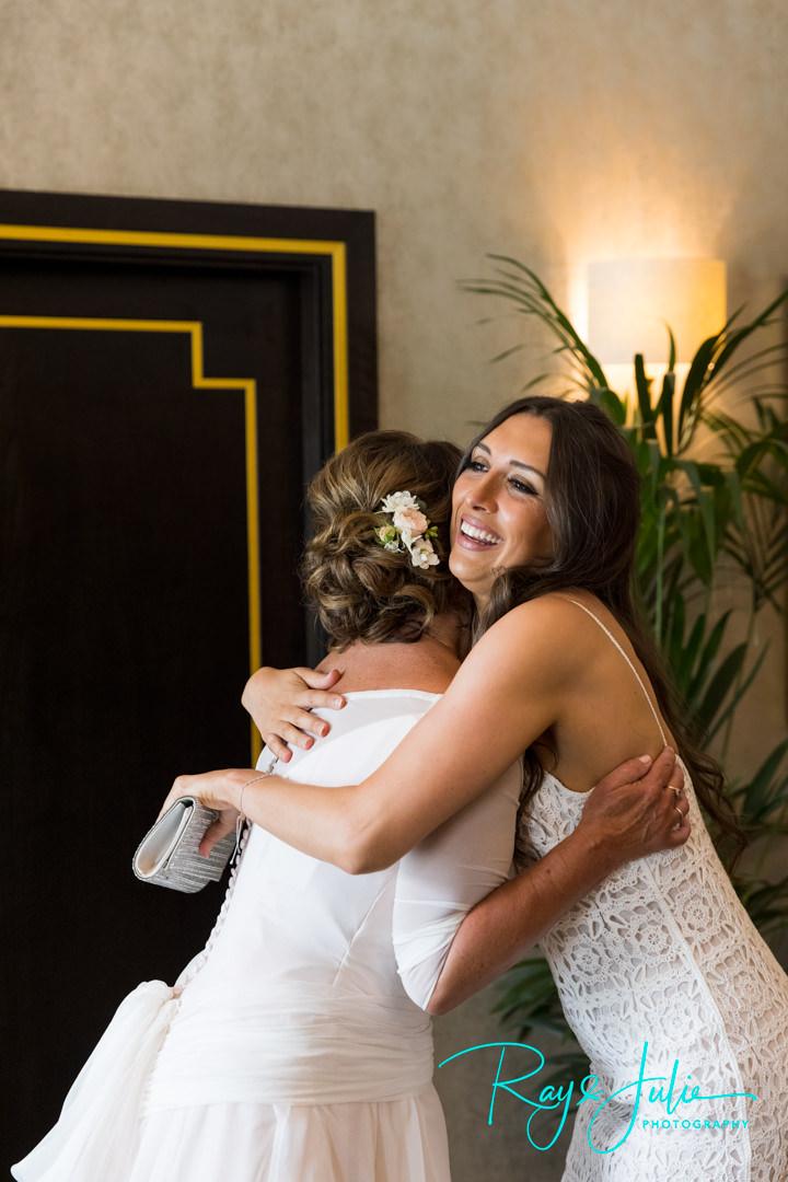 Bride hugging daughter at Grantley Hall in the Presidential Suit