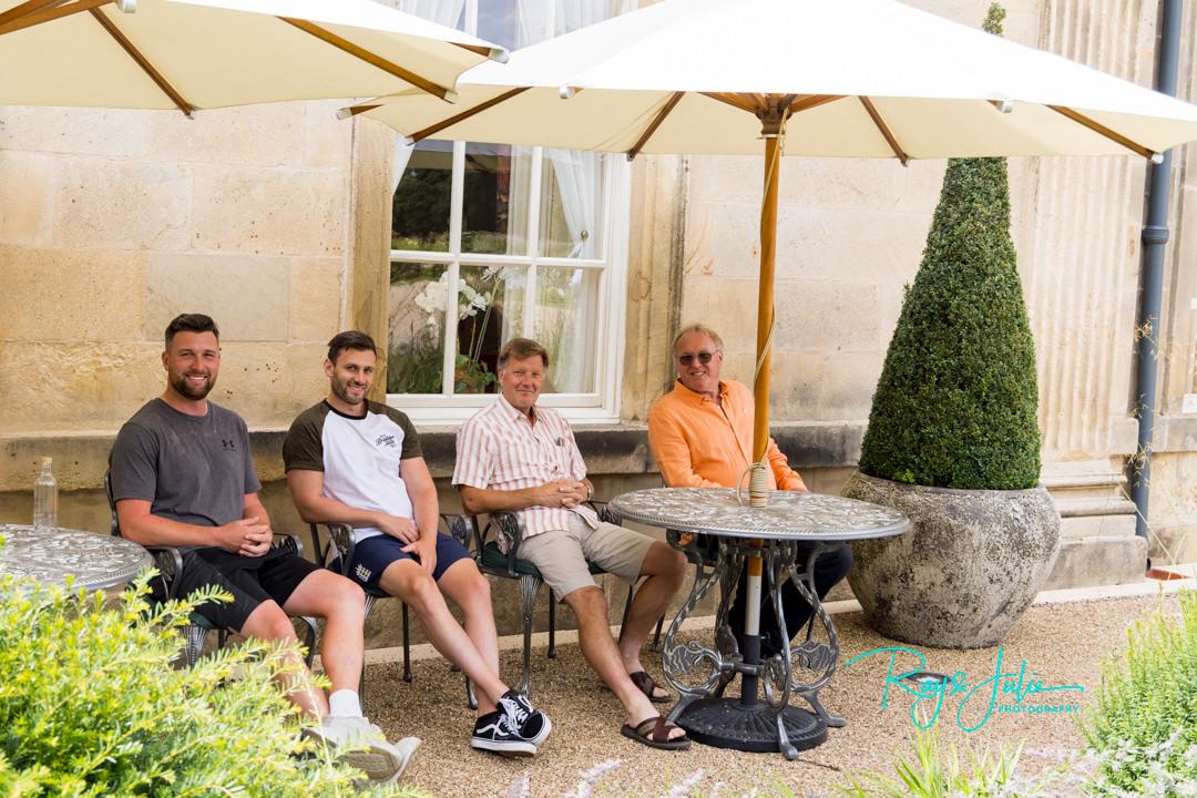 Groom and Groomsmen sat outside Grantley Hall relaxing