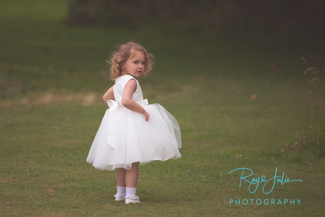 Beautiful flower girl portrait. Yorkshire wedding venue.