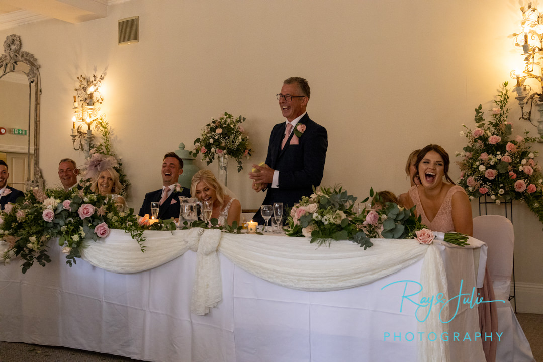 Wedding speech everyone on the top table laughing