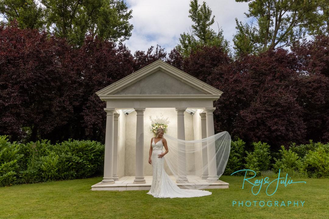 Stunning bride in wedding dress with Tickton Grange feature behind.