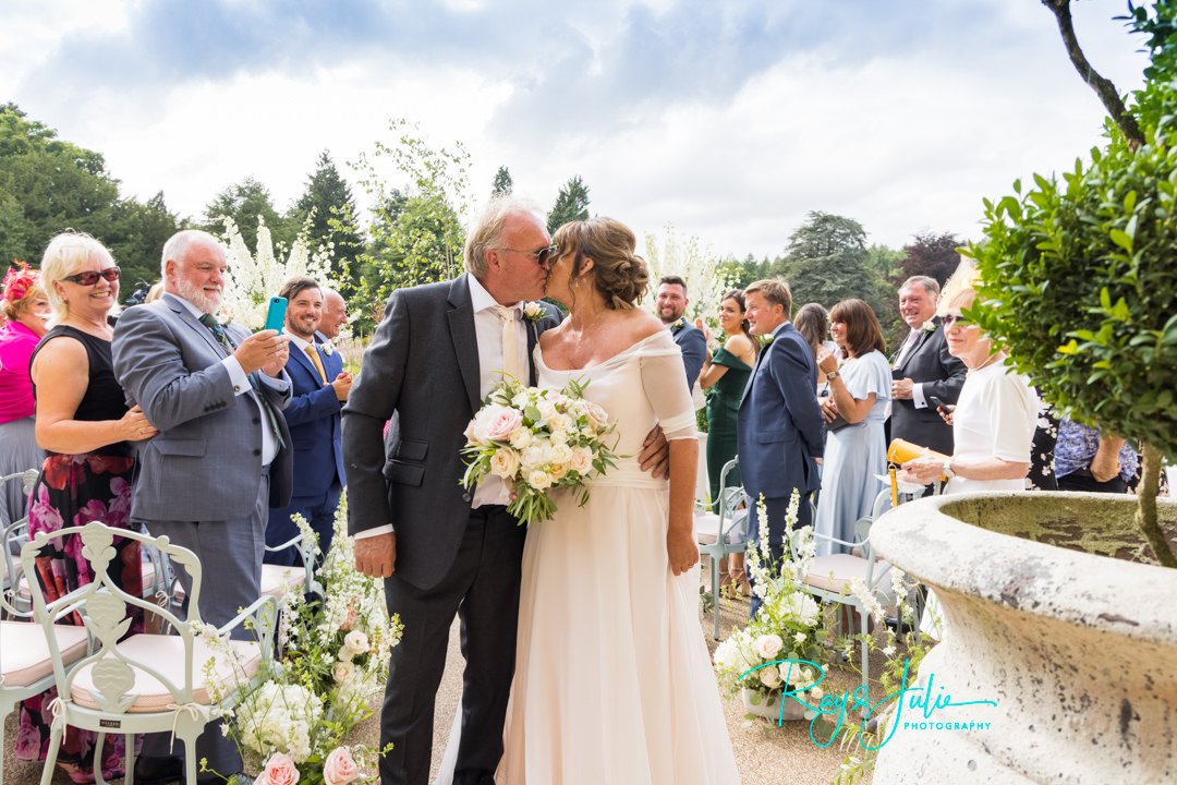 Bride and Groom exchange a kiss after there wedding ceremony