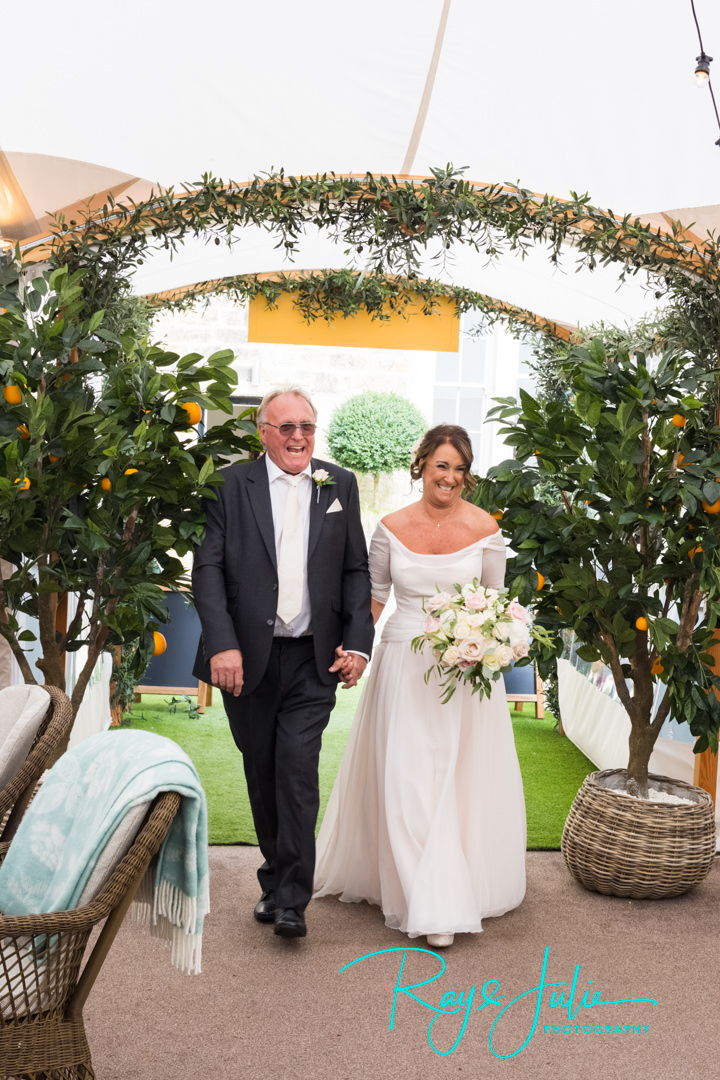 Bride and groom making their entrance into The Orchard at Grantley Hall