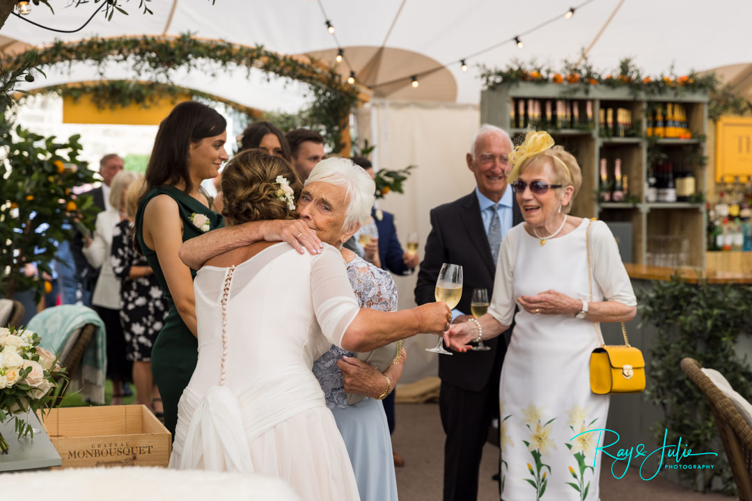 Bride hugging mum after wedding ceremony at The Orchard at Grantley Hall